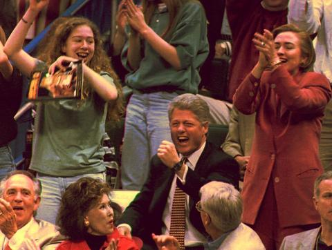 Bill Clinton cheers on the University of Arkansas' men's basketball team in 1994.
