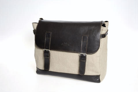 """""""[This] linen satchel is similar to one commissioned by the late Luciano Pavarotti for travel. His only requirement is that it was oversized,"""" said Marc Sklar, co-owner of Gian Marco Menswear in Baltimore. $350 and exclusively at Gian Marco Menswear."""