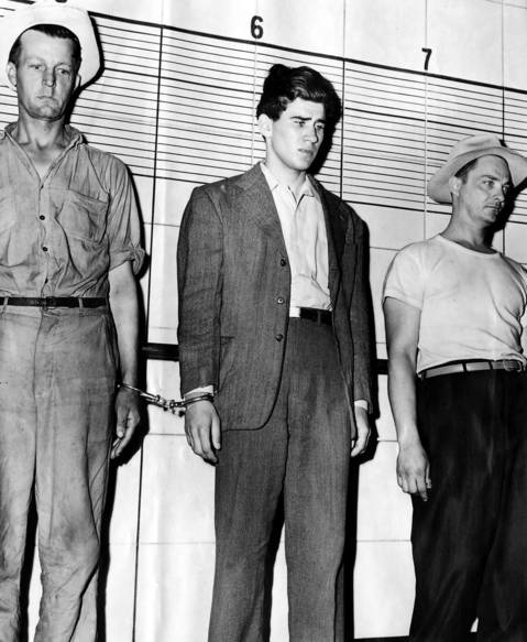 University of Chicago student William Heirens, 17, center, in a lineup at Chicago Police headquarters on July 1, 1946.
