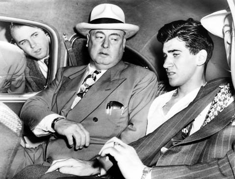 William Heirens, center, is flanked by Chicago detective chief Storms, left, and police captain Michael Ahern as Heirens is taken to a detective bureau lineup on July 1, 1946.
