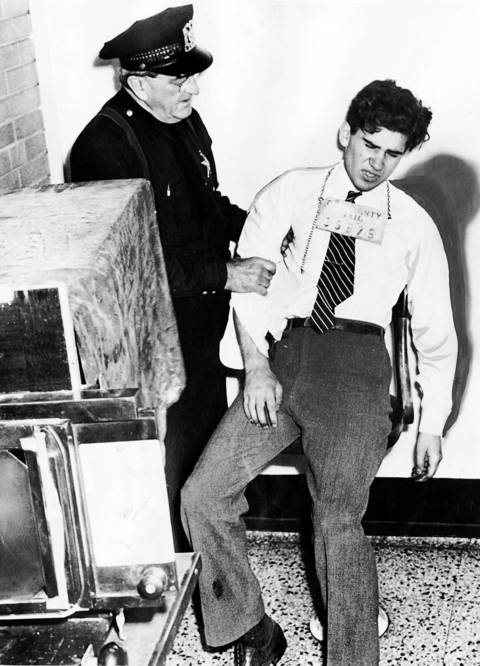 """""""Lipstick Killer"""" William Heirens, 17, being photographed by an identification worker at Cook County jail in 1946. Shortly afterward, he collapsed. He was convicted of kidnapping, strangling, and dismembering 6-year-old Suzanne Degnan on Jan. 7, 1946."""