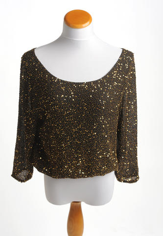 This dazzling top from Alice + Olivia is perfect for the holiday season. $368 at L'Apparenza.