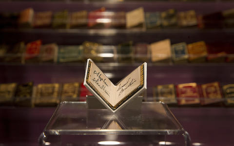 """Miniature books on display from """"Colleen Moore's Fairy Castle"""" at the Museum of Science and Industry."""