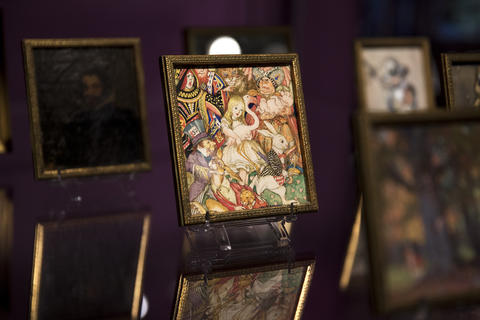 """Items including tiny paintings on display from """"Colleen Moore's Fairy Castle"""" at the Museum of Science and Industry."""