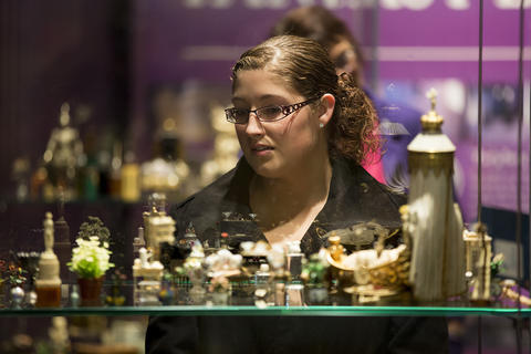 """Alyssa Jamison, from Fort Wayne, Ind., looks at items on display from """"Colleen Moore's Fairy Castle"""" at the Museum of Science and Industry."""