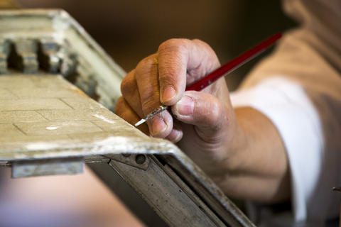 """Conservator Inez Litas works on restoring """"Colleen Moore's Fairy Castle"""" at the Museum of Science and Industry."""
