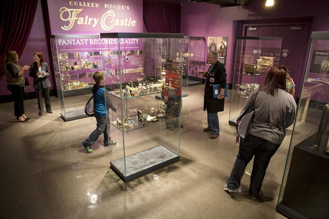 """Guests view individual pieces on display from """"Colleen Moore's Fairy Castle"""" at the Museum of Science and Industry."""