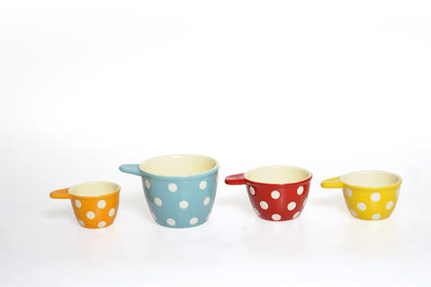 Dip, level and pour is much more fun with dots. These ceramic measuring cups add spark to any recipe. $14 at Stebbins Anderson