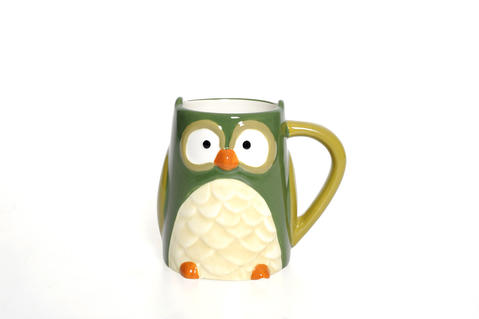 Owl-shaped ceramic coffee cup is right on trend and fun, too. $12 at Su Casa