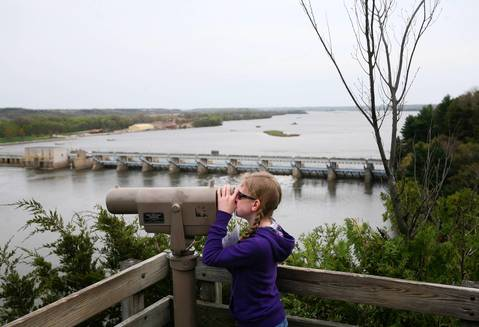 Kayla Bruce of Lake Zurich takes in the view over the Illinois River at Starved Rock State Park.