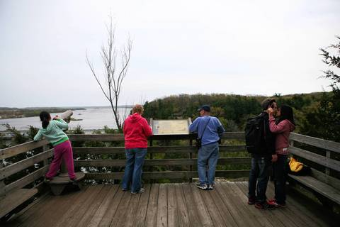 People enjoy views of the Illinois River at at Starved Rock State Park.