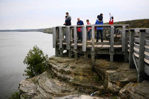 People look out from a platform above the Illinois River in Starve Rock State Park.