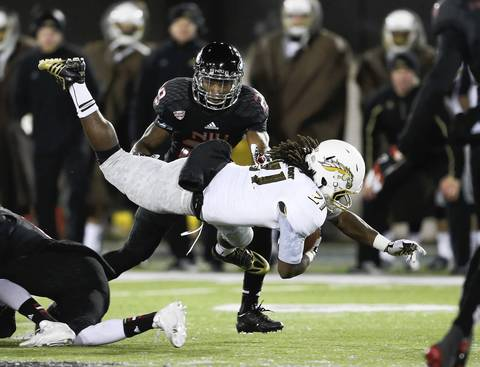 Western Michigan running back Antoin Scriven goes airborne as he tries to gain some yards in front of Paris Logan during the second half.