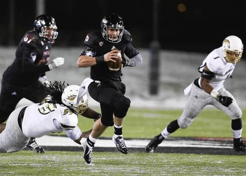 Northern Illinois quarterback Jordan Lynch carries the ball for some yardage against Western Michigan during the first half.