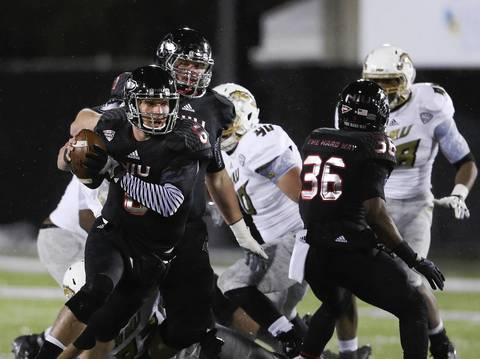 Northern Illinois quarterback Jordan Lynch runs with the ball against Western Michigan during the first half.