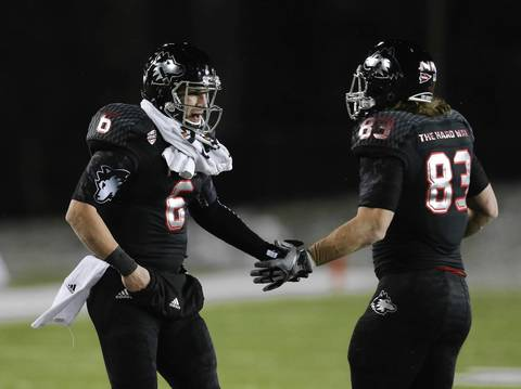Jordan Lynch with tight end Luke Eakes during the first half.