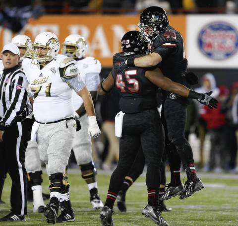Northern Illinois linebackers Sean Folliard and Boomer Mays celebrat after stopping the Western Michigan from getting a first down during the first half.
