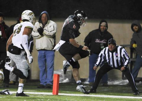 Quarterback Jordan Lynch scores a touchdown in front of Western Michigan linebacker Jake Minster during the first half.