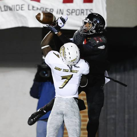 Wide receiver Juwan Brescacin catches a touchdown pass in front of Western Michigan's Ronald Zamort during the first half.