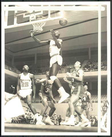 Walt Bellamy leaps to grab a rebound against St.Louis as teammate Gus Johnson (25) and the Hawks' Zelmo Beaty (31) and Bob Pettit (9) watch.