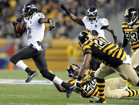 Ravens punt returner Jacoby Jones races past a group of Steelers defenders for a 63-yard touchdown in the second quarter. The Ravens held on for a 13-10 win over the Steelers, who were playing without quarterback Ben Roethlisberger.