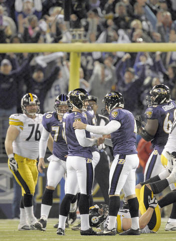 Ravens holder Sam Koch, right, congratulates kicker Billy Cundiff on his 29-yard field goal in overtime that sealed a 20-17 win over the Steelers . The game-winning kick was set up when rookie Paul Kruger intercepted third-string quarterback Dennis Dixon, who started in place of Ben Roethlisberger .