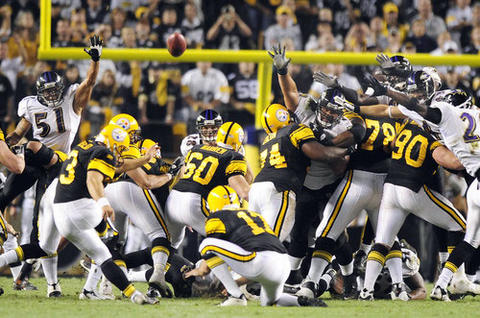 Steelers kicker Jeff Reed hits a 46-yard field goal in overtime, lifting Pittsburgh to a 23-20 win over the Ravens, who suffered their first loss of the season. The Ravens, who led 13-3 late in the third quarter, lost for the seventh straight time in prime time.