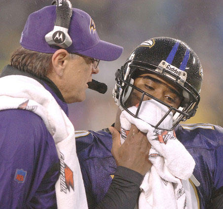 Ravens head coach Brian Billick talks to rookie quarterback Troy Smith during a first-half timeout against the Steelers . Smith went 16-for-27 for 171 yards and one touchdown, leading the Ravens to a win over the playoff-bound Steelers in the regular-season finale. Billick was fired the next day.