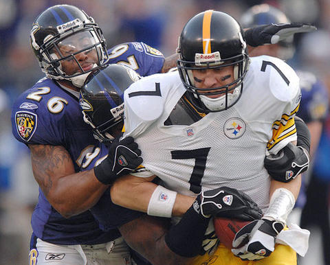Dawan Landry and Trevor Pryce bring down Steelers quarterback Ben Roethlisberger in the third quarter. The defense hit Roethlisberger on 41 percent of his passes, tying a team record with nine sacks and knocking him down eight other times.