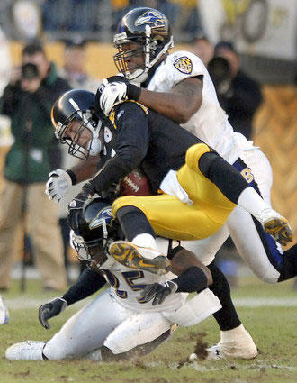 Ben Roethlisberger, sandwiched by Corey Ivy (left) and Terrell Suggs in the second half, was sacked five times and intercepted twice. The Ravens defense held the Steelers to 251 total yards and forced three turnovers.