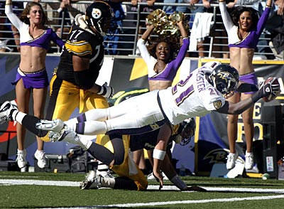 Ravens cornerback Chris McAlister dives over Ben Roethlisberger and the goal line on a 51-yard interception return for a touchdown. Pittsburgh had scored 13 fourth-quarter points to close within 10, but McAlister's score gave the Ravens a 30-13 victory.