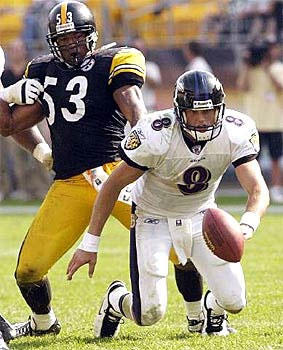 Rookie quarterback Kyle Boller, who was 22-for-43 for 152 yards in his debut, chases down his fumble as Pittsburgh's Clark Haggans closes in. The Ravens' 19-point loss to their AFC North rival represented the worst season-opening loss in the franchise's history.