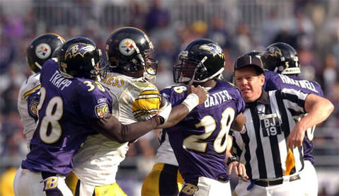 Gary Baxter (28) tries to break up an altercation between Ravens defensive back James Trapp (38) and the Steelers receiver Plaxico Burress (80) after Trapp intercepted a pass during the second quarter. Both Trapp and Burress were ejected from the game. The Ravens were flagged 13 times for 100 yards and turned the ball over five times.