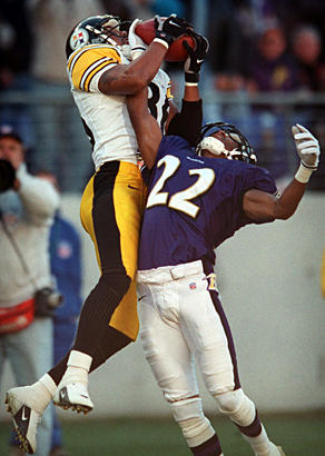 Steelers wide receiver Hines Ward (left) leaps over Ravens cornerback Duane Starks for a 45-yard touchdown reception from Kordell Stewart in the third quarter. The Ravens managed only two field goals by Matt Stover in the 9-6 loss.