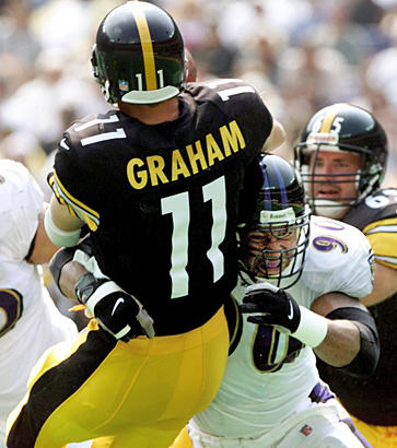 Defensive end Rob Burnett (right) sacks Steelers quarterback Kent Graham during the first quarter of the Ravens' 16-0 victory. It was the first of four shutouts for the Ravens during the 2000 season that culminated in a Super Bowl win.