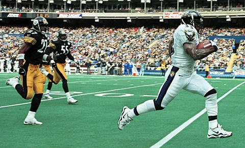 Ravens running back Priest Holmes (right) breaks free for a 64-yard rushing touchdown against the Steelers . Holmes ran for 130 yards on 18 carries, and quarterback Tony Banks tossed three touchdowns in the Ravens' 31-24 victory.