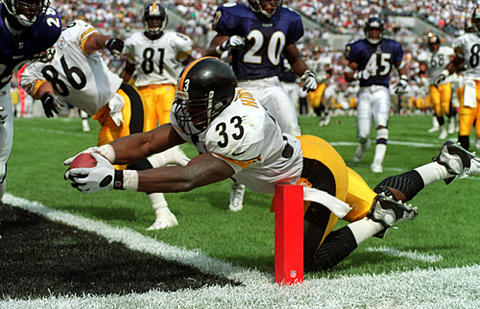Steelers running back Richard Huntley dives for the end zone on a 17-yard touchdown run in the second quarter. Errict Rhett rushed for 101 yards and a touchdown for the Ravens , but they lost to the Steelers, 23-20.