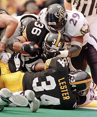 Ravens safety Eric Turner (right) fails to stop Steelers running back Jerome Bettis at the goal line during the first meeting between the two teams. Along with this touchdown, Bettis rushed for 116 yards on 21 carries in Pittsburgh's 31-17 victory.