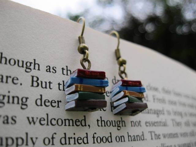 Have books hang from ears with these earrings from the Coryographies Etsy store. ($13.24, etsy.me/1cFonaM)