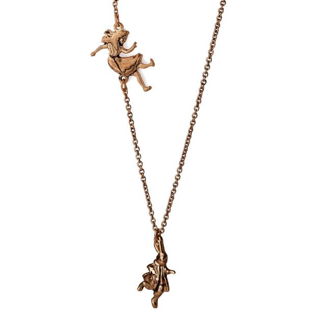 "Relive the wonders of ""Alice in Wonderland"" with this ""Down the Rabbit Hole"" necklace by Out of Print. ($32, bit.ly/1ibm4Rl)"