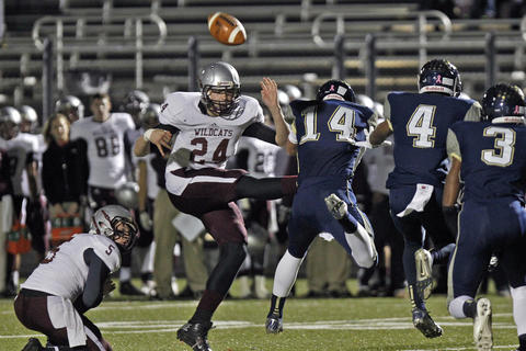 Lafayette's Brendan McGinty, center, blocks the field goal attempt by Warren County's Blake Steele during Friday's second round playoff game at Wanner Stadium.