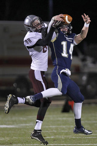 Lafayette's Brendan McGinty, right, intercepts a ball intended for Warren County's Casey Stewart during Friday's second round playoff game at Wanner Stadium.