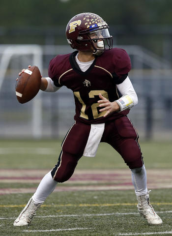Poquoson's quarterback Johnny Pryce during a home game against Petersburg on Saturday, November 16, 2013.