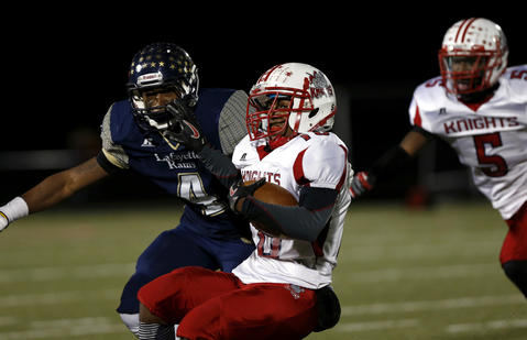 Sportsylvania's Blair Lawson is tackled by Lafayette's Jahlil Green during a game at Wanner Stadium in James City County, Virginia on Friday, November 15, 2013. Photo by Jesse Hutcheson,