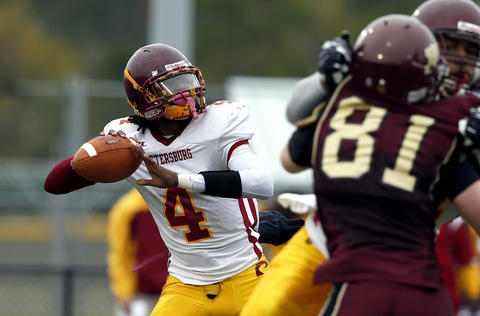 Petersburg's quarterback Levy Jones IV during a game against Poquoson on Saturday, November 16, 2013.