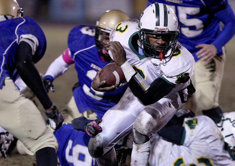 Richard Tayor of Bruton picks his way through the Smithfield defense during the second quarter Friday at Smithfield.
