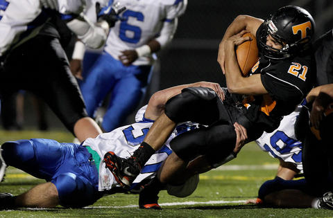 Bailey Hicks of Tabb is brought down by Marcus Wakelyn of York during the second quarter Friday at Bailey Field.