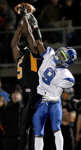 Deshon Jones of York breaks up this pass intended for Antwuan Hicks Jr. of Tabb during the second quarter Friday at Bailey Field.