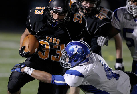 Brent Hinson of Tabb is brought down by Jordan West of York during the first quarter Friday at Bailey field.