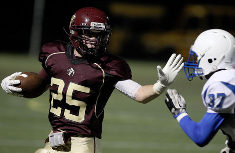 Ethan Bryce of Poquoson tries to get around Darren Jones of New Kent during the second quarter Thursday at Poquoson.